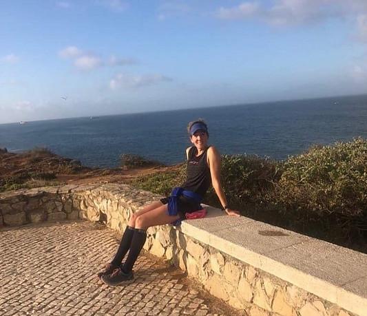 Trail runner relaxing by the ocean